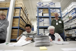 Election judges Willy Lee (L) and Joanne Caspersen recount marked ballots cast for the 2008 Minnesota U.S. senate race between former Saturday Night Live comedian Al Franken (DFL-MN) and incumbent Norm Coleman (R-MN) at an elections warehouse in Minneapolis November 19, 2008.   REUTERS/Eric Miller (UNITED STATES)