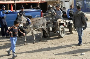 U.S. Army military police and Iraqi police play with children in Sab al Bor, Iraq, Dec. 22, 2007. (U.S. Air Force photo by Tech. Sgt. William Greer)
