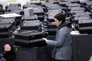 A recount worker searchs for the ten correct ballot boxes on her list, which were then opened up and looked into for uncounted ballots at the Minneapolis recount site on Wednesday, Dec. 3, 2008. (Pioneer Press: Scott Takushi)