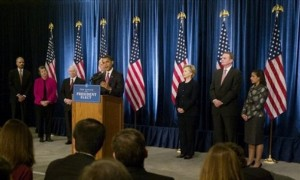 President-elect Barack Obama takes questions from reporters during a news conference in Chicago, Monday, Dec. 1, 2008, with, from left to right: Attorney General-designate Eric Holder; Homeland Security Secretary-designate Janet Napolitano; Defense Secretary Robert Gates; Vice President-elect Joe Biden; Secretary of State-designate Sen. Hillary Rodham Clinton, D-N.Y.; National Security Adviser-designate Ret. Marine Gen. James Jones; and United Nations Ambassador-designate Susan Rice.