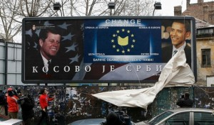 """Activists of youth movement, Europe Has No Alternative, unveil a billboard showing former U.S. President John F. Kennedy and Democratic presidential hopeful U.S. Senator Barack Obama in Belgrade March 1, 2008. The billboard reads: """"Barack Obama, be always with us"""" and """"Kosovo is Serbia"""". The youth movement tries to underline the need for developing a dialogue with the world, opposing the policy of self-isolation."""