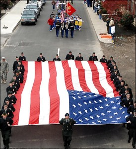 Veterans Day in Maysville, Ky. Photo Credit: By Terry Prather -- Associated Press