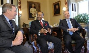llinois U.S. Senate Appointee Roland Burris, center, and Sen. Richard Durbin, D-Ill., left, meet with Senate Majority Leader Harry Reid of Nev., on Capitol Hill in Washington, Wednesday, Jan. 7, 2009. (AP Photo/Susan Walsh)