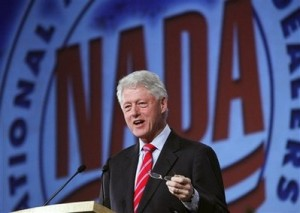 Former President Bill Clinton speaks to the National Automobile Dealers Association during their meeting in New Orleans Monday, Jan. 26, 2009. (AP Photo/ Judi Bottoni)