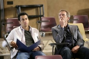 Hugh Laurie, right, and Kal Penn are shown in a scene from the Fox series, 'House.' (AP Photo/FOX, Adam Taylor)