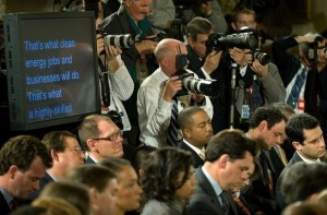 "News photographers surround the teleprompter as US President Barack Obama delivers opening remarks during his primetime press conference in the East Room of the White House on March 24, 2009 in Washington. Obama told his crisis-weary nation he sees signs of economic progress but pleaded for ""patience"" as he battles to overcome the worst financial maelstrom in decades."