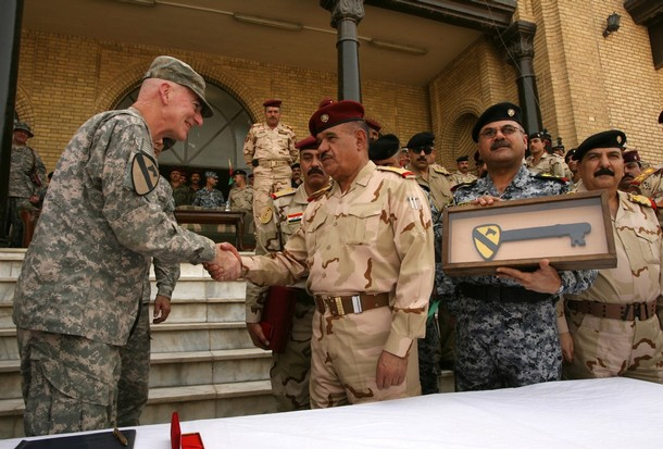 US General Daniel Bolger (L), commander of US forces in Baghdad shakes hands with General Abud Qambar, commander of Baghdad Operation Command, after handing him a symbolic key of the1st Cavalry Division at the old Iraqi Defence Ministry, the last of the 86 positions occupied by the US military in Baghdad since the US-led invasion in 2003, on June 29, 2009. US combat troops will pull out from Iraq's cities and main towns June 30 as the war-torn country takes sole charge of security in a major stepping stone to a complete American withdrawal.  AFP PHOTO / ALI AL-SAADI (Photo credit should read ALI AL-SAADI/AFP/Getty Images)