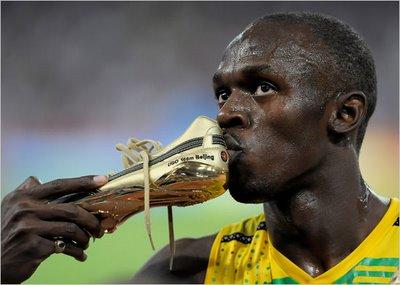 Usain Bolt Kissing Shoe Photo