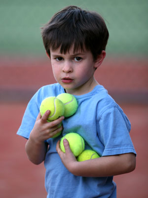 boy-with-tennis-balls