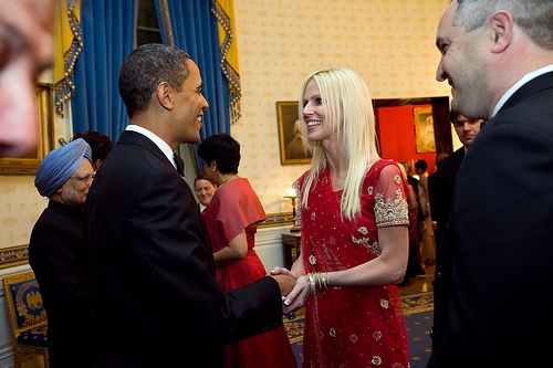 President Barack Obama greets Michaele and Tareq Salahi during a receiving line in the Blue Room of the White House before the State Dinner with Prime Minister Manmohan Singh of India, Nov. 24, 2009. (Official White House Photo by Samantha Appleton)  This official White House photograph is being made available only for publication by news organizations and/or for personal use printing by the subject(s) of the photograph. The photograph may not be manipulated in any way and may not be used in commercial or political materials, advertisements, emails, products, promotions that in any way suggests approval or endorsement of the President, the First Family, or the White House.