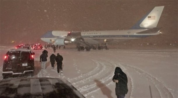 The presidential motorcade heads towards Air Force One to pick up President Barack Obama, not pictured, during a snow storm at Andrews Air Force Base, Md. , as he returned from the climate conference in Copenhagen, early Saturday, Dec. 19, 2009. President Obama typically travels via Marine One helicopter from Andrews Air Force Base to the White House but a motorcade was used due to inclement weather.