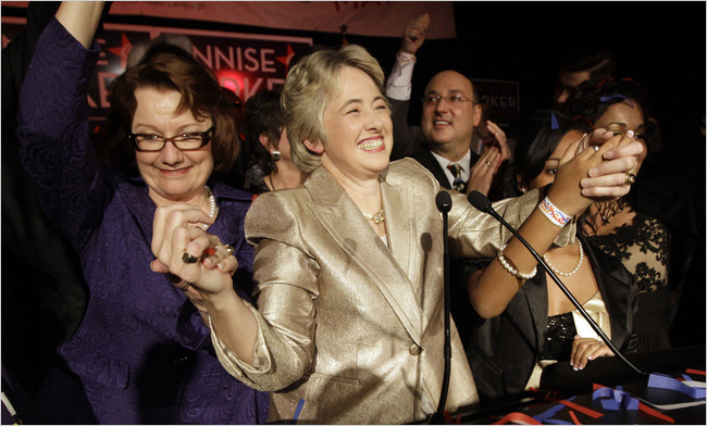Houston Mayor-elect Annise Parker, center, celebrates with her partner Kathy Hubbard, left, Parker's runoff election victory at a campaign party on Saturday in Houston. David J. Phillip/Associated Press