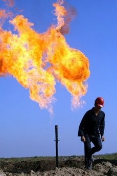 An Iraqi worker walks at the Halfaya oil field near the southern city of Amara on December 12. Iranian forces have taken control of a southern Iraqi oil well on a disputed section of the border, US and Iraqi officials have told AFP. (AFP/Essam al-Sudani)