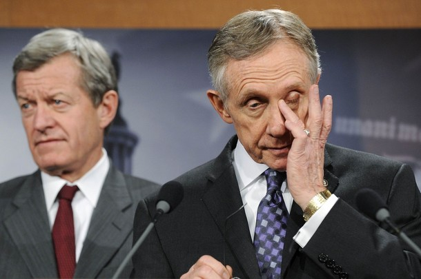Senate Majority Leader Harry Reid (D-NV) (R) wipes his eyes as he and Senator Max Baucus (D-MT) (L) address senate health care legislation at the US Capitol in Washington December 19, 2009. U.S. Senate Democrats reached a compromise on Saturday with holdout Senator Ben Nelson that secured the 60 votes they need to pass the broad healthcare overhaul sought by President Barack Obama. (Reuters Pictures)