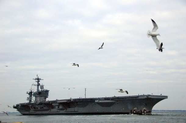 In this handout image provided by the U.S. Navy, the Nimitz-class aircraft carrier USS Carl Vinson (CVN 70) departs Naval Station Norfolk January 12, 2010 of the coast of Norfolk, Virginia. Carl Vinson is underway following a four-year refueling and complex overhaul to take part in Southern Seas 2010. After completing Southern Seas, Carl Vinson will change homeport from Norfolk, Va. to San Diego, Calif. (Photo by Petty Officer 2nd Class Rafael Martie/U.S. Navy via Getty Images)