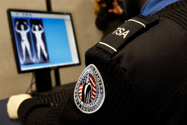 """Transportation Security Administration Security Officer Nyamsi Tchapleu looks at images created by a """"backscatter"""" scanner during a demonstration at the Transportation Security Administration's Systems Integration Facility at Ronald Reagan National Airport December 30, 2009 in Arlington, Virginia. Backscatter technology uses low level x-rays to create a two-sided image.  (Photo by Chip Somodevilla/Getty Images)"""