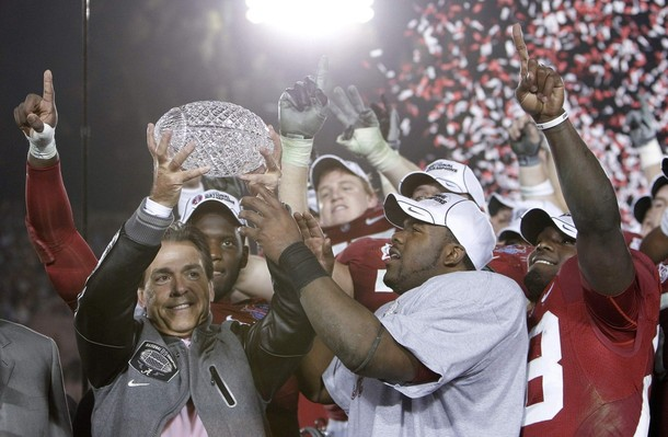 Head coach Nick Saban (L) of the Alabama Crimson Tide and Heisman trophy winner Mark Ingram (R) hold the championship trophy after their team defeated the Texas Longhorns in the NCAA's BCS National Championship football game in Pasadena, January 7, 2010.  (Reuters Pictures)