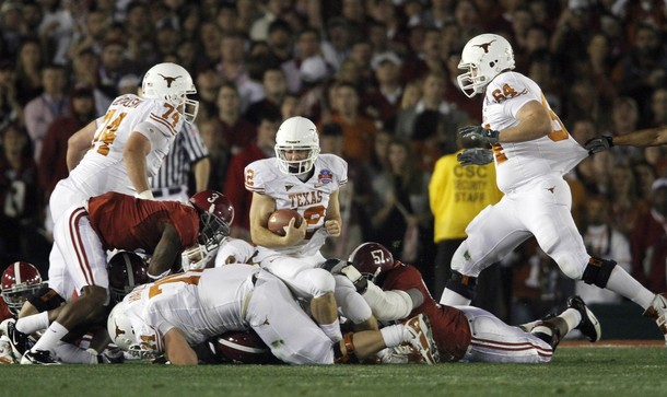 Texas Longhorns quarterback Colt McCoy (C) is injured as he is hit by Alabama Crimson Tides Marcel Dareus (R) in the first quarter in the NCAA's BCS National Championship football game in Pasadena, January 7, 2010.