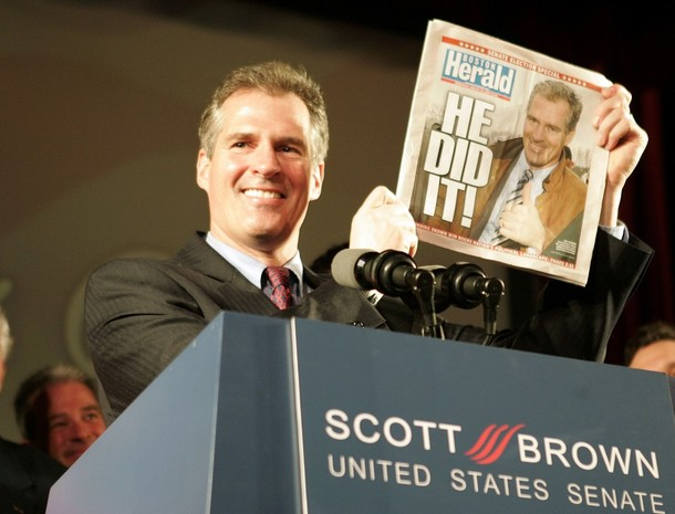 Republican U.S. Senator-elect Scott Brown holds up a copy of the Boston Herald announcing his victory over Democrat Martha Coakley in Boston, Massachusetts January 19, 2010.   REUTERS/Adam Hunger   (UNITED STATES - Tags: POLITICS ELECTIONS)