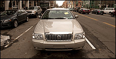 The abandoned car in traffic lane at 15th Street NW. (Marvin Joseph/The Washington Post)