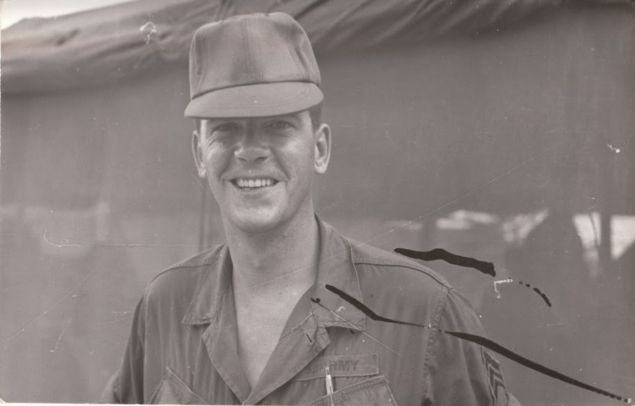 Another rare photo in which he's smiling.  Judging from the uniform and tent, I'd guess Vietnam.