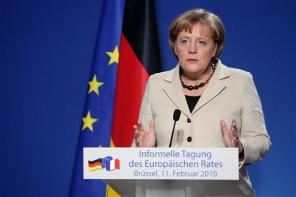 "German Chancellor Angela Merkel gestures while speaking during a media conference after an EU summit in Brussels, Thursday, Feb. 11, 2010. Germany and France dangled a limited promise of ""political support""  but no financial aid for debt-burdened Greece at a meeting of European Union leaders Thursday, trying to defuse market fears about the about the future of the euro and Europe's economic unity. (<i></i>)"