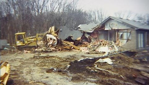 Terry Hoskins Bulldoze House Mortgage Foreclosure Photo