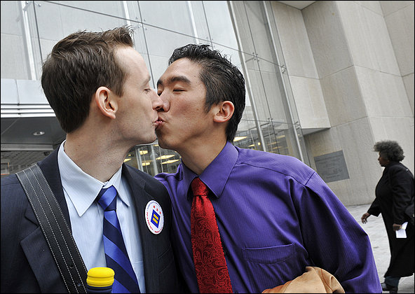 Two happy couples express their enthusiasm as the District begins taking applications for marriage licenses from same-sex couples. At top are Jeremy Ames, left, and Taka Ariga. Photo Credit: Photos By Bill O'leary/the Washington Post Photo
