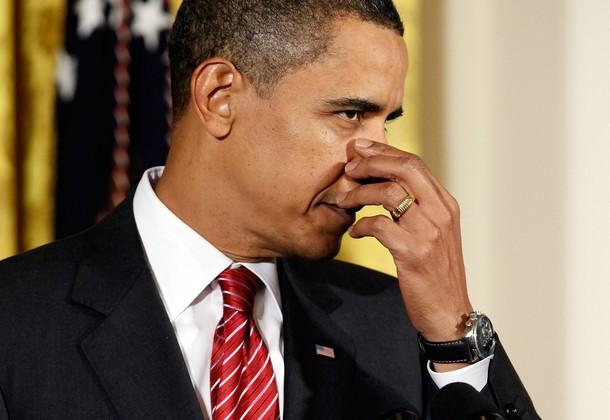 Obama Holds Nose