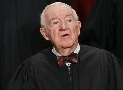 In this Sept. 29, 2009, file photo Associate Justice John Paul Stevens sits for a new group photograph at the Supreme Court in Washington. Stevens, the oldest justice who turns 90 this April 2010, says he'll decide soon about retiring, for his own peace of mind and to give President Barack Obama and the Senate plenty of time to replace him. (AP Photo/Charles Dharapak, File)