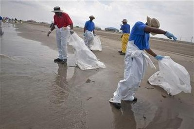 BP workers pick up tar balls from Deepwater Horizon oil leak along beach in Grand Isle
