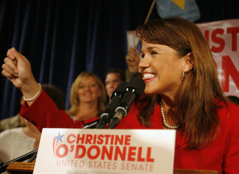 Delaware Republican senatorial candidate Christine O'Donnell gesture while speaking about winning in the Republican primary at her campaign victory event in Dover