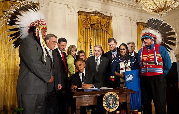 US President Barack Obama, surrounded by