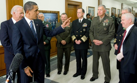 US President Barack Obama, with US Vice President Joe Biden (L) and Chairman of the Joint Chiefs of Staff, Admiral Mike Mullen (C), speaks alongside the Joint Chiefs of Staff and US Secretary of Defense Robert Gates (R) after meetings at the Pentagon in Washington, DC, January 28, 2009. AFP PHOTO /  SAUL LOEB/AFP/Getty Images