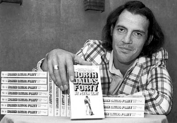 "Former Dallas Cowboys flanker and author Peter Gent poses with copies of his bestseller, ""North Dallas Forty,"" in New York. (Associated Press / August 26, 1974)"