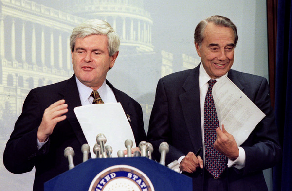 House Speaker Newt Gingrich and Senate Majority Leader Robert Dole joke with reporters November 13 a..