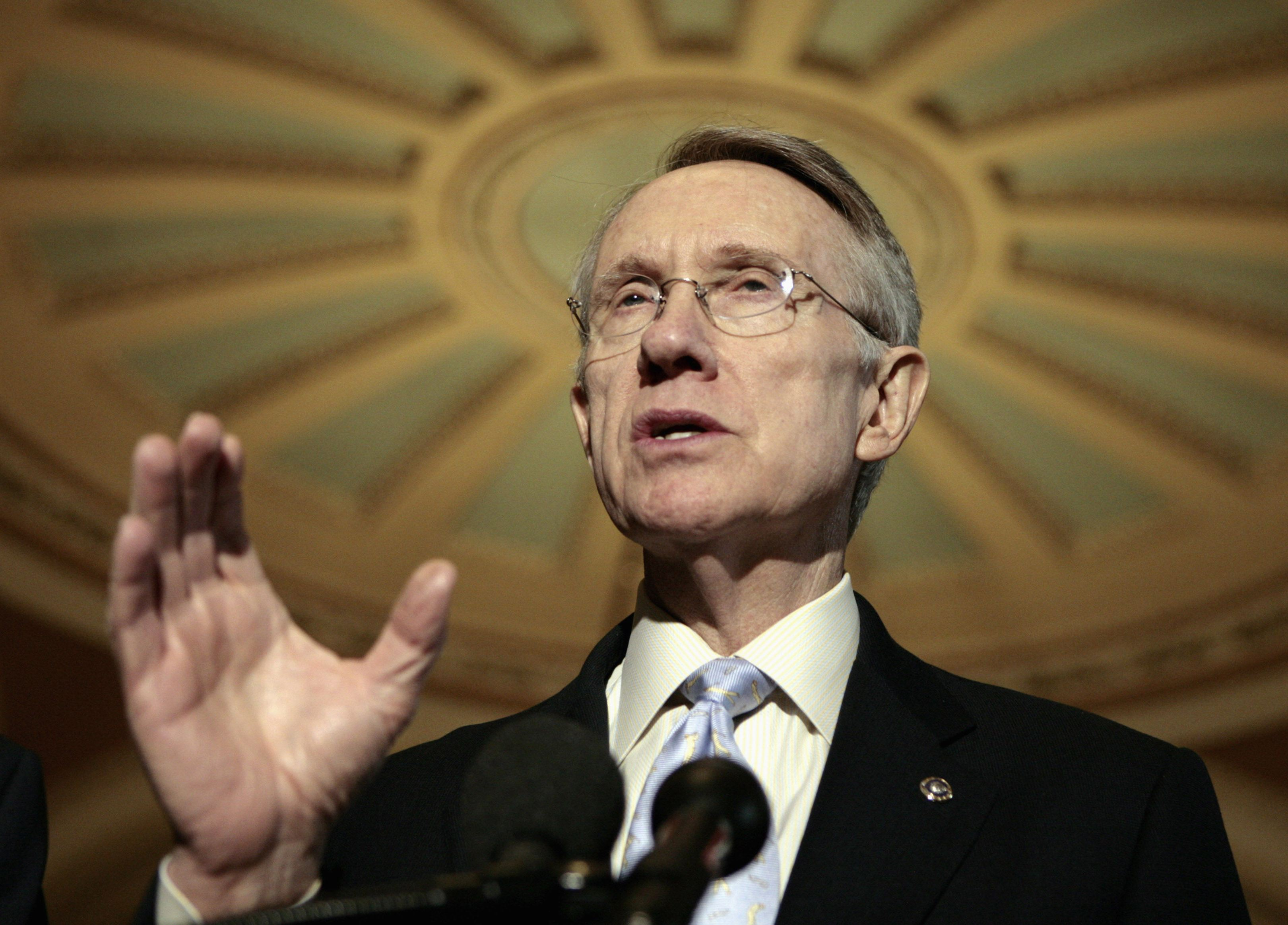 Senator Harry Reid speak to reporters in the Capitol in Washington