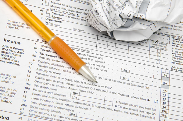 tax-forms-pen-crumpled-paper