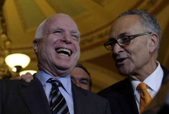 McCain shares a laugh with Chuck Schumer, D-NY