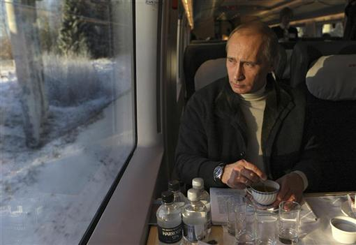Russia's Prime Minister Vladimir Putin travels in Russia's first high speed train Sapsan in Leningrad Region
