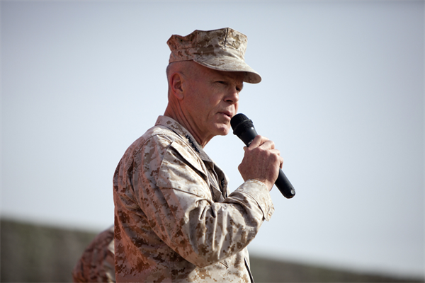 Commandant of the Marine Corps, Gen. James F. Amos, addresses a crowd of U.S. Marines and Sailors at Camp Leatherneck, Afghanistan Dec. 23. Amos expressed his admiration to the service members for their accomplishments and dedication to supporting the ongoing counterisurgency mission, especially while deployed during