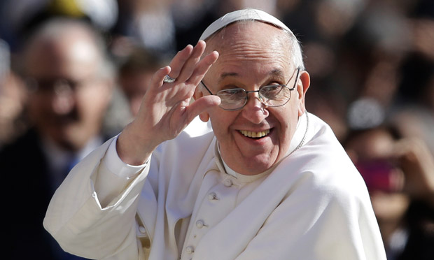 Pope Francis waves to crowds as he arrives to his inauguration mass on 19 March 2013.
