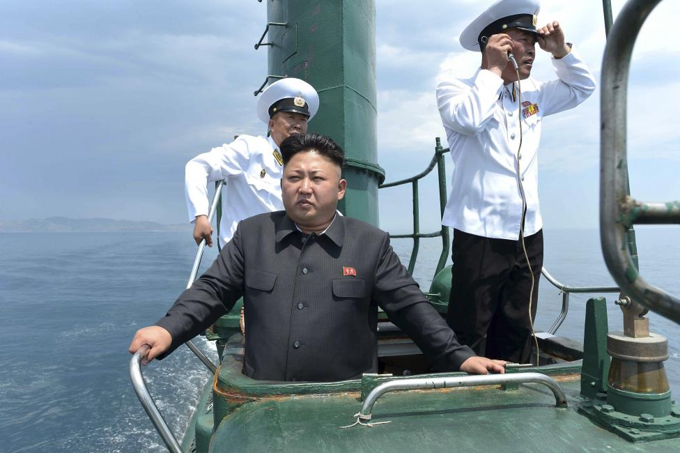 North Korean leader Kim Jong Un stands on the conning tower of a submarine during his inspection of the KPA Naval Unit 167