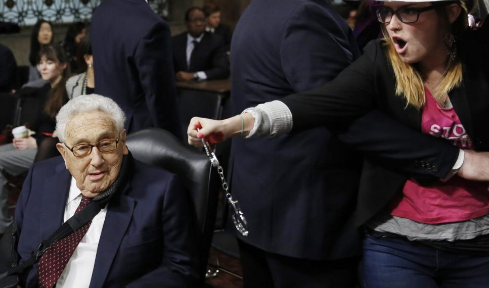 Code Pink Scum interrupt Henry Kissinger