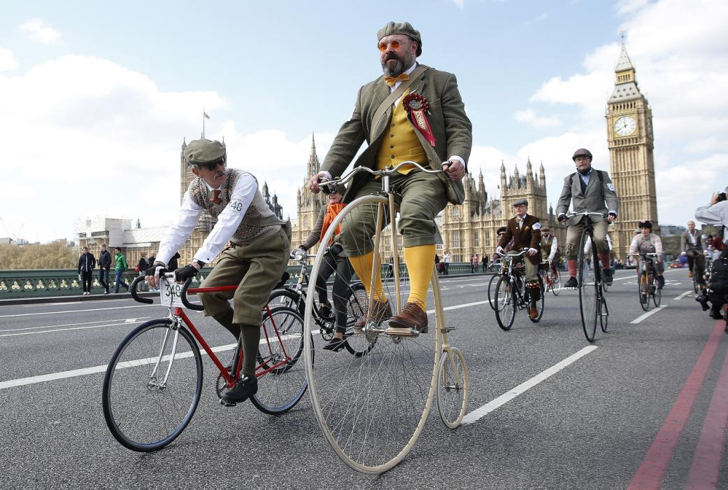 Participants in the Tweed Run ride their bicycles over Westminster Bridge in central London