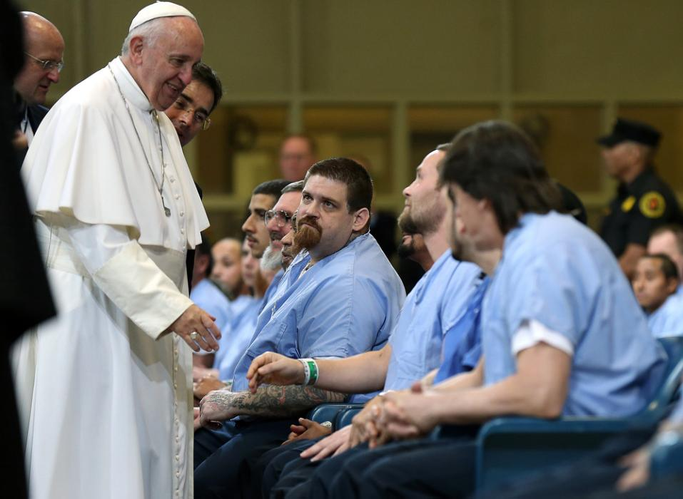 Pope Francis greets inmates during his visit to Curran Fromhold Correctional Facility in Philadelphia, Sunday, Sept. 27, 2015. (David Maialetti/The Philadelphia Inquirer, Pool)