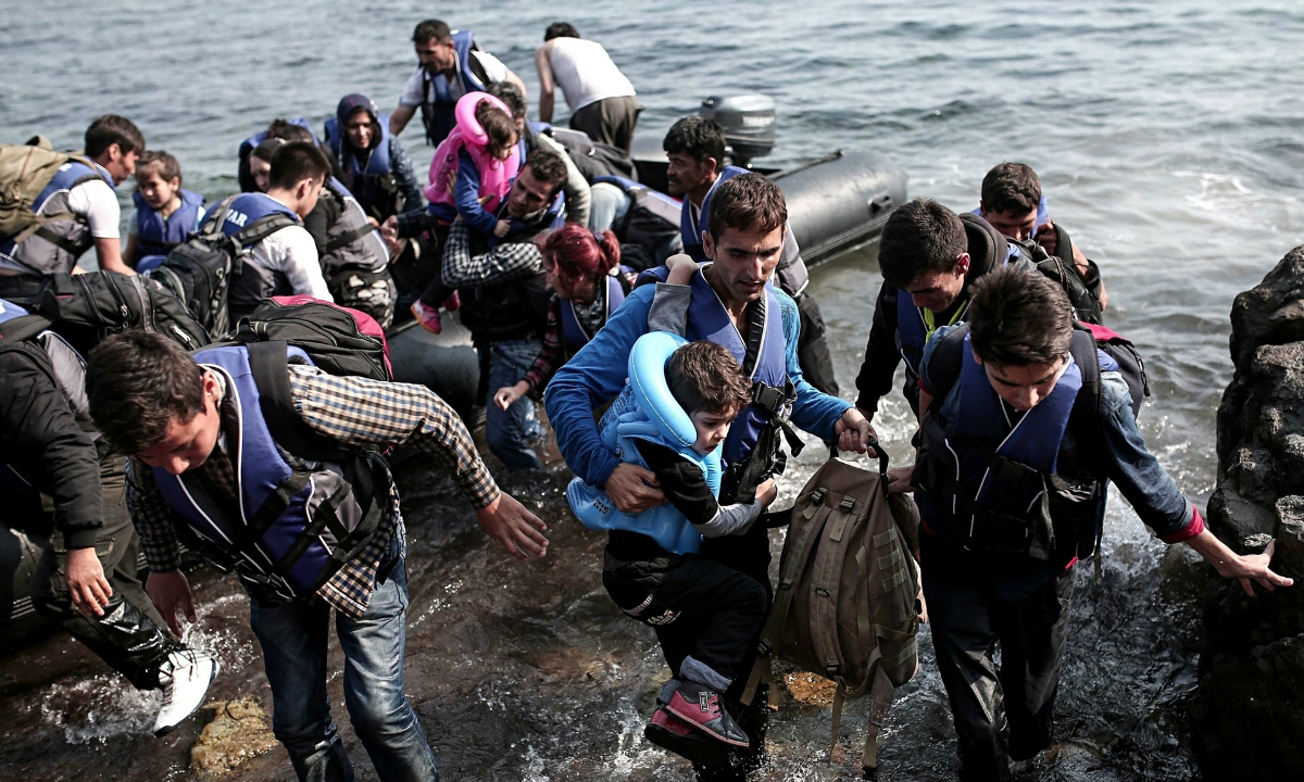 Syrian Refugees Coming Ashore In Greece
