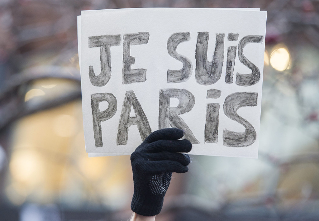 "A man holds up a sign which reads, ""Je Suis Paris"" (""I Am Paris"") during a rally of solidarity outside the Consulate of France in Montreal, Quebec, Canada on Saturday, Nov. 14, 2015, to show his support to victims of the Paris attacks. (Graham Hughes/The Canadian Press via AP)"