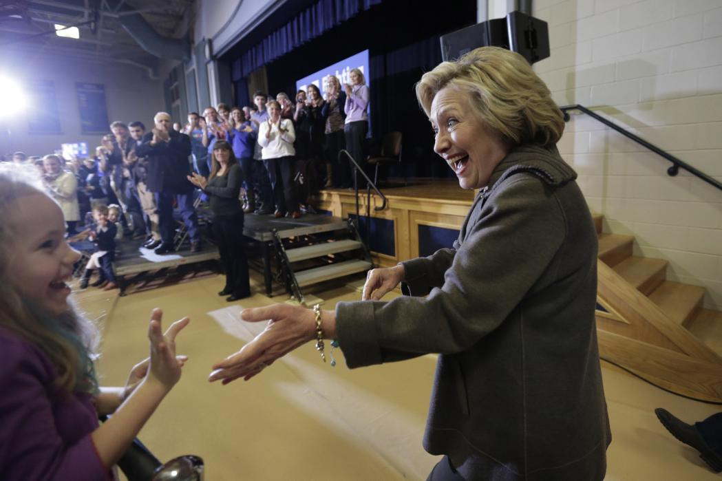 Democratic presidential candidate Hillary Clinton, right, greets people in the audience as she arrives at a town hall campaign event, Sunday, Jan. 3, 2016, in Derry, N.H. (AP Photo/Steven Senne)