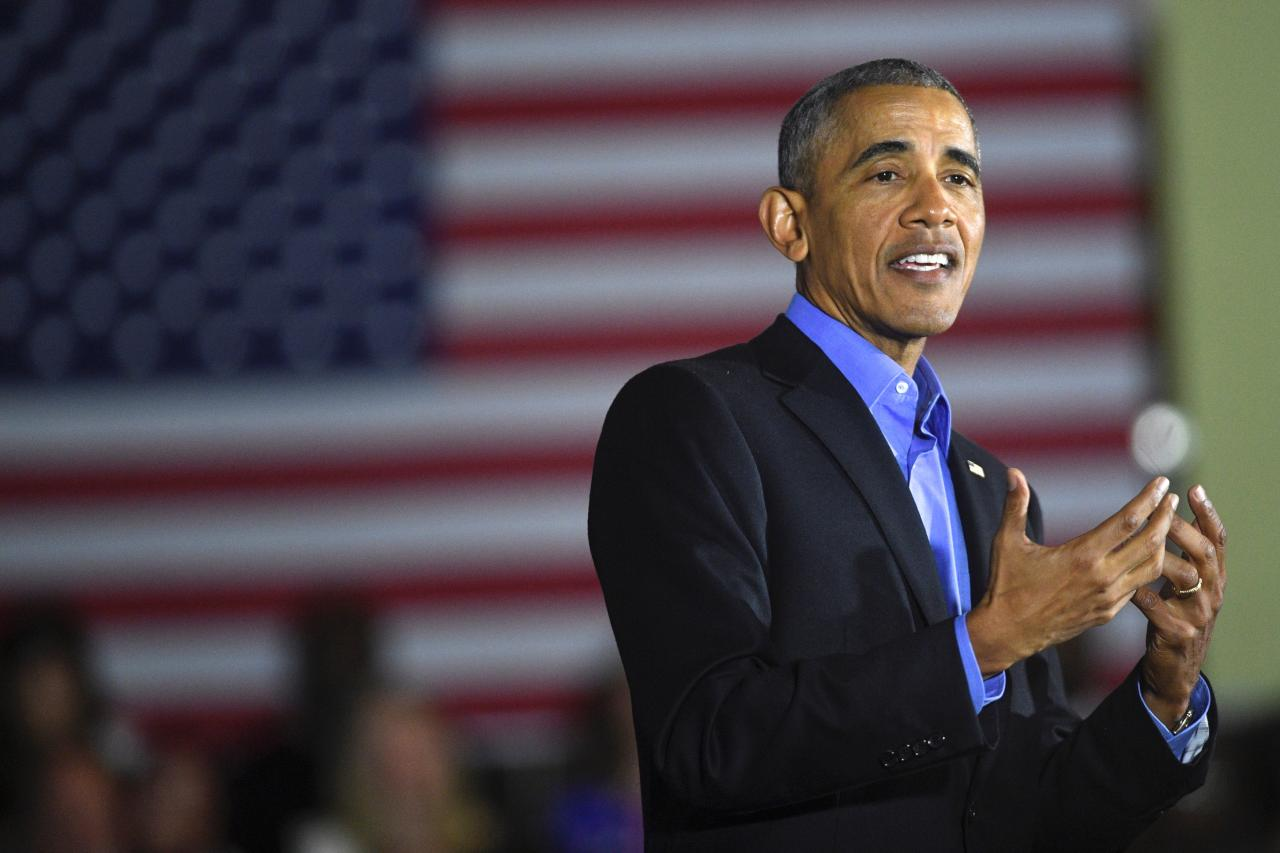 Former President Barack Obama speaks at a rally with New Jersey Democratic Gubernatorial candidate Jim Murphy